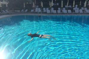 Lorde floating in the pool of her hotel in Rome this week.