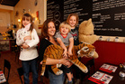 Danielle Nichol with Ben, Lucy, left, and Sophia at the Dutch Delight cafe in Birkenhead. Photo / Chris Gorman