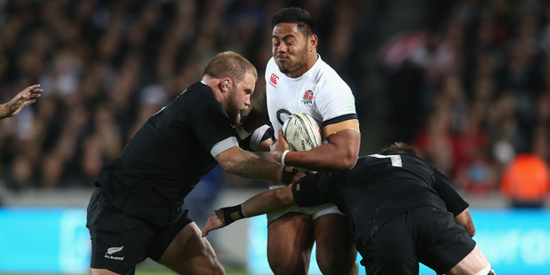 Owen Franks is making sure England's Manu Tuilagi can't get away. Photo / Getty Images