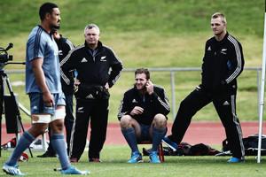 Injured players, Kieran Read and Sam Cane of the All Blacks look on from the sidelines as Jerome Kaino runs through drills during a New Zealand All Blacks training. Photo / Getty.