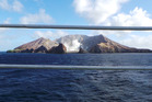 White Island viewed through the safety rail of a cruise ship. Photo / Winston Aldworth