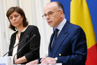 French Interior Minister Bernard Cazeneuve, right, said the new arrests took place in the Paris region and the south of France. Photo / AP