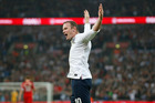 Wayne Rooney says he has been training hard and is happy to play in whatever position England manager Roy Hodgson asks him to take. Photo / AP