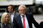 Rolf Harris, centre, arrives for his trial with his daughter Bindi. Photo / AP