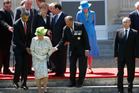 US President Barack Obama and Governor-General Jerry Mateparae assist Queen Elizabeth. Photo / AP