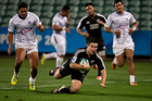 NZ 2nd-five Jackson Garden-Bachop scores against Samoa, at the IRB Junior World Championship 2014. Photo / Brett Phibbs
