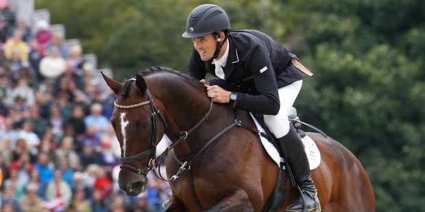 New Zealand's Jock Paget and Clifton Promise in action during the eventing show jumping at Greenwich Park Equestrian Centre in London. Photo / New Zealand Herald