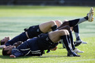 Players stretch at the England Rugby Team training run. Photo / NZPA