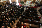 Hundreds of people gather at St Mary's Church in Northcote for the funeral of Bessie Gotingco. Photo / Greg Bowker