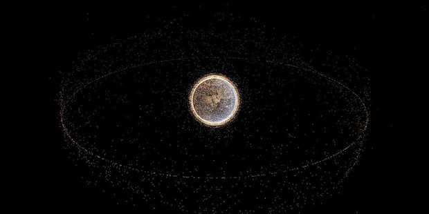 Space debris can whip around the world as fast as 17,000 mph. Rendered image using NORAD data. Every point represents a piece of space debris in the NORAD catalog. Photo / Wikipedia-Yeus