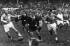 All Black Don McKay (centre) races for the ball against wing Jean Dupuy (left) during France's 1961 tour of New Zealand. Photo / NZ Herald Archives