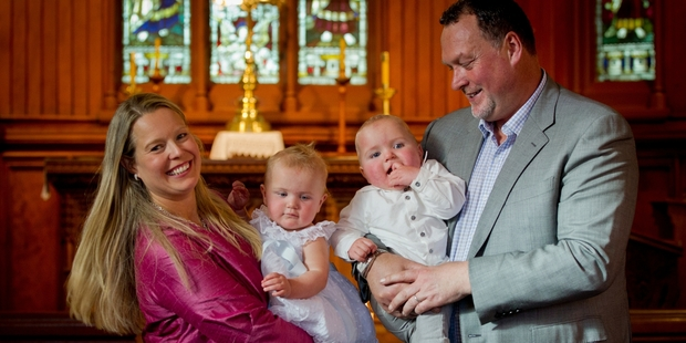 Jane (left) and Martin Weekes had  twins Parker (with Martin) and Poppy (with Jane) christened.