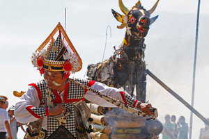 A Balinese dancer performs during a cremation ceremony at a beach in Bali. Photo / AP