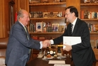 King Juan Carlos, left, with Prime Minister Mariano Rajoy last night.