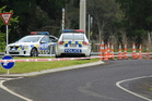A cordon at the intersection of State Highway 2 and Higginson Road where police shot David Taite. Photo / APN