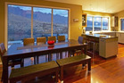 This large home with spectacular views overlooking Queenstown can be hired through the Airbnb website.