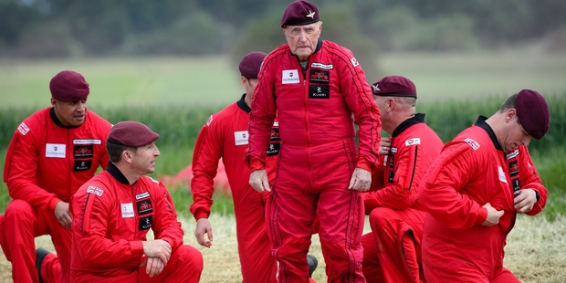 D-Day veteran Jock Hutton (centre), 89, was the only paratrooper at Ranville, Normandy, this year to repeat the jump he made into machine-gun fire in the June 6, 1944 invasion force. Photo / AP