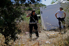 A British policewoman uses ground-penetrating radar inside a cordoned-off area in Praia da Luz. Photo / AP