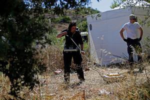 A British policewoman uses ground-penetrating radar inside a cordoned-off area in Praia da Luz. Photo / AP