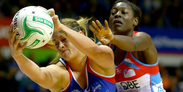 Catherine Latu of the Mystics gets posession ahead of Sonia Mkoloma of the Swifts. Photo / Getty Images