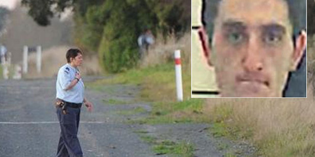 A corrections officer participates in a hunt for Stephen Maddren (inset) along State Highway One near Milton. Photo / ODT/ NZ Police