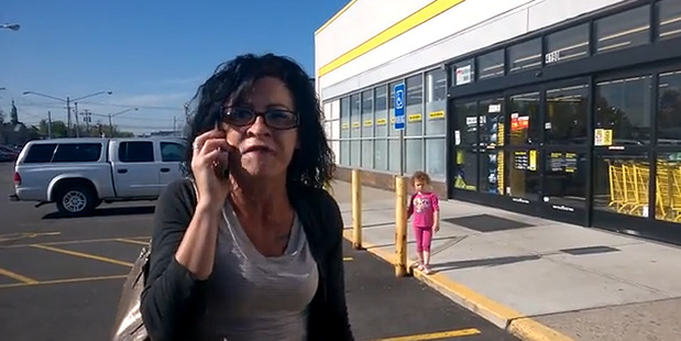 A woman has been filmed launching into a racist tirade outside a supermarket. Photo / YouTube