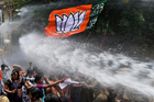 A water cannon douses protesters in India. Photo / AP