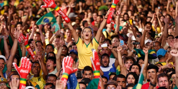 The World Cup can tell you lots about a country's national characteristics. Here a Brazilian fan cheers her team in the 3-1 win against Croatia. Photo / AP