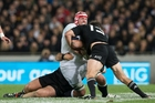 One of England's stampeding rhinos, No8 Ben Morgan, is tackled by All Black prop Owen Frank and Ben Smith. Photo / Greg Bowker