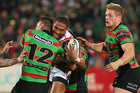 Manu Vatuvei of the Warriors is tackled against the Rabbitohs. Photo / Getty Images