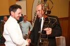 Graeme Hodges receives his award from Hawke's Bay Growers president Leon Stallard.. Photo/Supplied