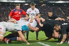 Referee Nigel Owens guides England's Ben Youngs as Aaron Smith looks on. England's set-piece work was painfully slow on Saturday. Picture / Greg Bowker