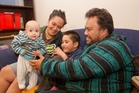 Te Atakura Mokotupu with Hawea, 9 months, Nga toi o rangi Mokotupu, 5, and Temu Mokotupu at home in Napier. Photo / Glenn Taylor