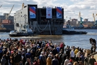 The stern of Sevastopol is launched at St Petersburg naval shipyard before being towed to France. Photo / AP