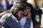 A Reynolds High School student is reunited with her mother after a shooting at her school, Oregon. Photo / AFP