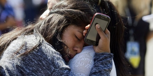 Loading A Reynolds High School student is reunited with her mother after a shooting at her school, Oregon. Photo / AFP