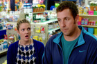 Drew Barrymore, left, and Adam Sandler appear in a scene from Blended. Photo/AP