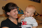 Nikau Karauti-McMenamin, 1, pictured with his mother Katie McMenamin, is excelling after having two cochlear implants. Photo / David Haxton