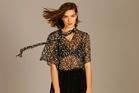 Helen Cherry silk blouse, $398. Vaughan Geeson skirt, $196. Photo / Chris Gorman