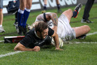 Conrad Smith scoring the match winning try against England. Photo / Greg Bowker