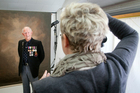 Tracy Stamatakos photographing a World War II veteran.