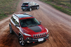 The Jeep Cherokee Trailhawk (front) and Limited (rear) look set to take on top European brands.