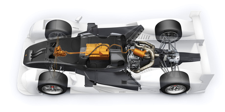 The V4 petrol engine with direct injection and turbocharging is integrated in the chassis as a mid-engine. Batteries in the centre supply the electric motor at the front axle with energy.