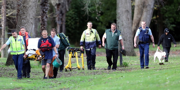 Emergency services assist a woman trapped in mud at Kowhai Park. Photo/Stuart Munro