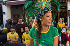 Brazilian dancer Aline Silva entertains the large crowd that gathered at Santos Cafe in Ponsonby for the opening of the Football Worldcup on Friday morning. Photo / Greg Bowker