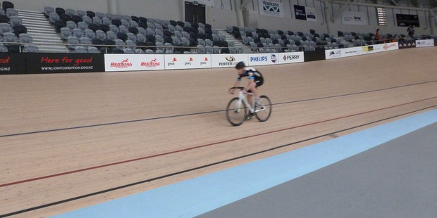 Chris Daniels works his way around the velodrome banking track.