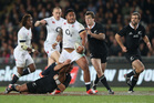 Manu Tuilagi of England is tackled by Aaron Cruden during the International Test Match between the New Zealand All Blacks and England at Eden Park. Photo / Greg Bowker.