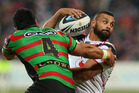 Jayson Bukuya of the Warriors looks to offload the ball while being tackled by Kirisome Auva'a of the Rabbitohs. Photo / Getty Images