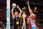 Ellen Halpenny of the Magic shoots during the match against the Sydney Swifts. Photo / Matt King