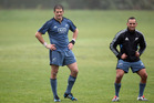 Richie McCaw and Aaron Cruden keep an eye on events during a New Zealand All Blacks training session at the University Oval, Dunedin on June 10, 2014 in Dunedin. Photo / Getty Images.